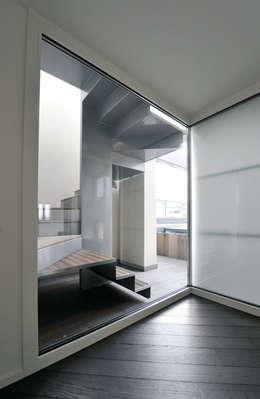 San Carlo: Ingresso & Corridoio in stile  di Massimo Vallotto Architetto