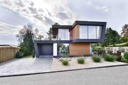 บ้านและที่อยู่อาศัย by m3 architekten