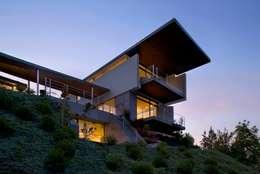 Casa Visiera: Case in stile in stile Moderno di ARCHICURA