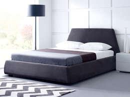 Dormitorios de estilo moderno por Living It Up