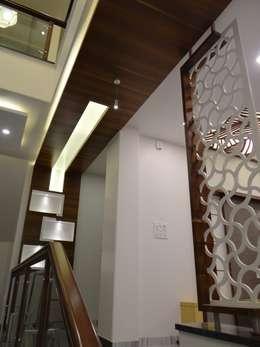 Pasillos y vestíbulos de estilo  por Hasta architects