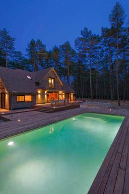 Maison ossature bois: Piscines  de style  par blackStones