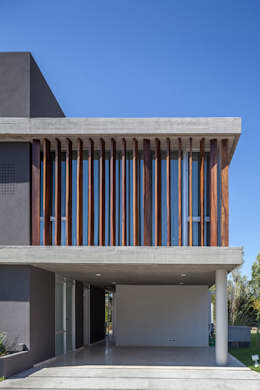 CASA HARAS: Casas de estilo moderno por ESTUDIO GEYA
