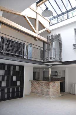 loft rue Servan Paris 11eme: Salon de style de style Industriel par jean-pierre gaignard