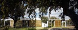 Correderas: Casas de estilo  de Murado & Elvira