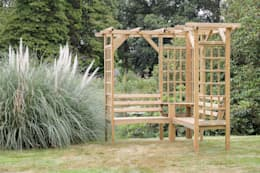 Your garden seat can also form a focal point. Use it as a plant climbing frame too.:  Garden  by Perfect Plants Ltd