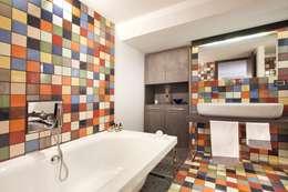 Baños de estilo industrial por vemworks
