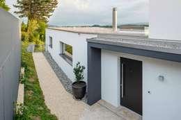 Projekty, nowoczesne Domy zaprojektowane przez Marty Häuser AG