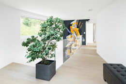 Projekty,  Korytarz, przedpokój zaprojektowane przez Marty Häuser AG