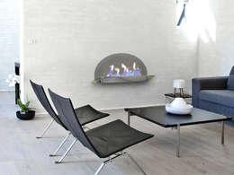 Chimeneas bioetanol pared SPA: Salones de estilo moderno de Shio Concept