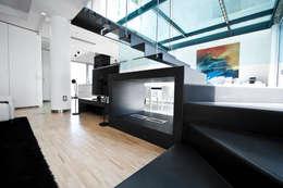 Projekty, nowoczesne Domy zaprojektowane przez Studio Merlini Architectural Concept