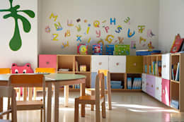 modern Nursery/kid's room by MOLUDO