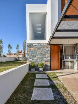Projekty, nowoczesne Domy zaprojektowane przez Estudio A+3