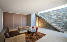 CASAS ADOSADAS: Livings de estilo moderno por Estudio A+3