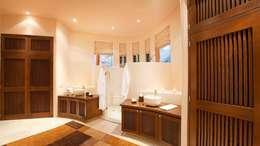 Casa Mariposa: Baños de estilo  por arqflores / architect