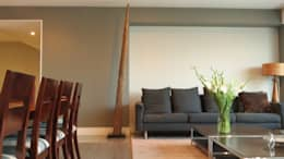 Salas de estilo moderno por NIVEL TRES ARQUITECTURA