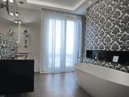 Salle de bains de style  par UTH living stone GmbH
