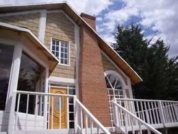 JRK Diseño - Studio Arquitectura: rustik tarz tarz Evler