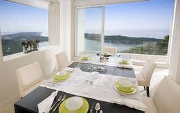 Casa blanca: Comedores de estilo moderno por BNKR Arquitectura