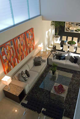 Estancia a doble altura.: Salas de estilo moderno por TaAG Arquitectura