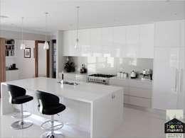 White Kitchen: classic Kitchen by home makers interior designers & decorators pvt. ltd.
