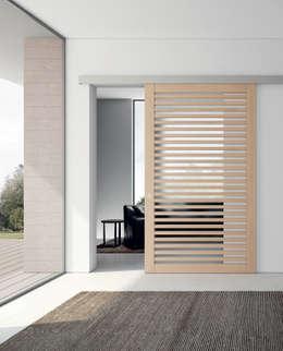 Couloir, Entrée & Escaliers de style de style Moderne par MOVI ITALIA SRL