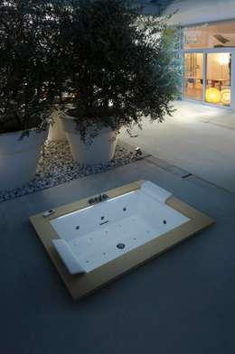 Baños de estilo  por Novellini
