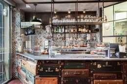 Tiendas y espacios comerciales de estilo  por Angelo Sabella Architetto