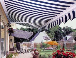 Jardines de estilo clásico por TOLDOS CLOT, S.L.