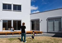クライミングウォールのある家: C lab.タカセモトヒデ建築設計が手掛けた庭です。