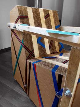 Sling Chair: Soggiorno in stile in stile Industriale di Dimondo Interior Design and Furniture