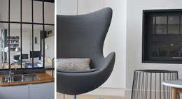 Salas de estilo moderno por A comme Archi