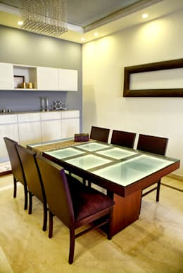 Dining: minimalistic Houses by Studio An-V-Thot Architects Pvt. Ltd.