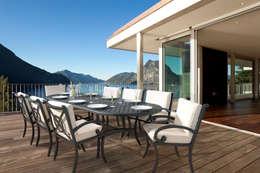 Terrazas de estilo  por Oxley's Furniture Ltd
