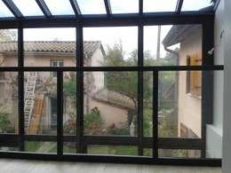 Maison ossature métallique: Terrasse de style  par Carole Guyon architecte