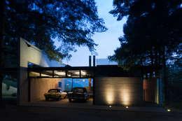 Estudios y oficinas de estilo minimalista por grupoarquitectura