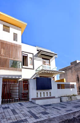 Front: modern Houses by Studio An-V-Thot Architects Pvt. Ltd.