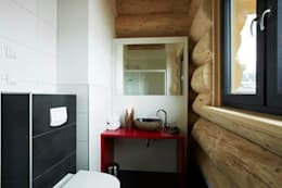 Ванные комнаты в . Автор – eb Massivhaus Deutschland GmbH