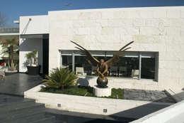 Casa Sauces: Casas de estilo  por ARCO Arquitectura Contemporánea