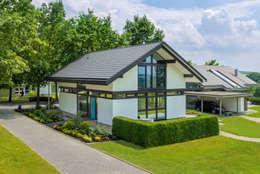 Projekty, nowoczesne Domy zaprojektowane przez HUF HAUS GmbH u. Co. KG