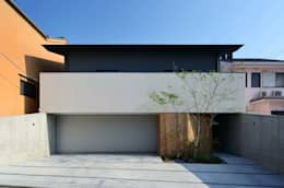 Garajes de estilo moderno por 設計組織DNA