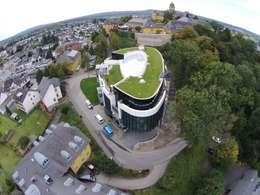 Tiendas y espacios comerciales de estilo  por Mechelk Bedachungstechnik GmbH