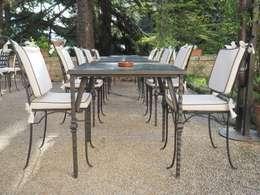 Iron age la nuova era dei tavoli in ferro battuto - Tavoli da giardino in marmo e ferro battuto prezzi ...