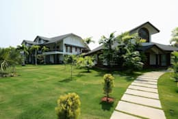 PRIVATE RESIDENCE AT KERALA(CALICUT)INDIA: classic Garden by TOPOS+PARTNERS