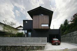生駒のgarage hause: 田中一郎建築事務所が手掛けた家です。