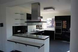 modern Kitchen by Heinrich Blohm GmbH - Bauunternehmen
