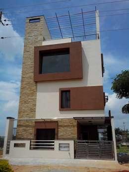 fachada hacia las alturas destacando las ventanas y dando al diseo con un de piedra lateral