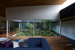 Livings de estilo moderno por 石井秀樹建築設計事務所