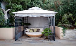 Jardines de estilo clásico por Home & Light