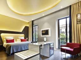 Hoteles de estilo  por BELTÁ & FRAJUMAR